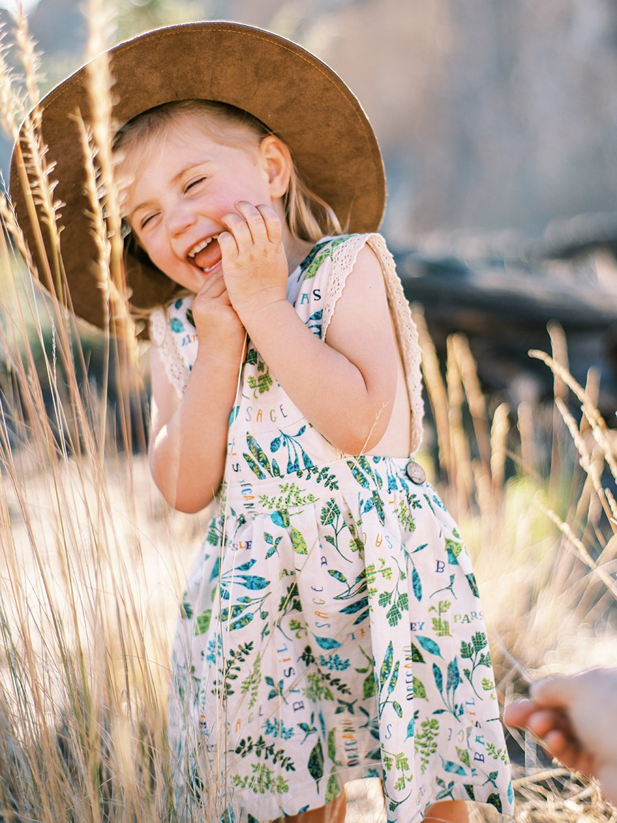 Little girl laughing. Photo by Marina Koslow.