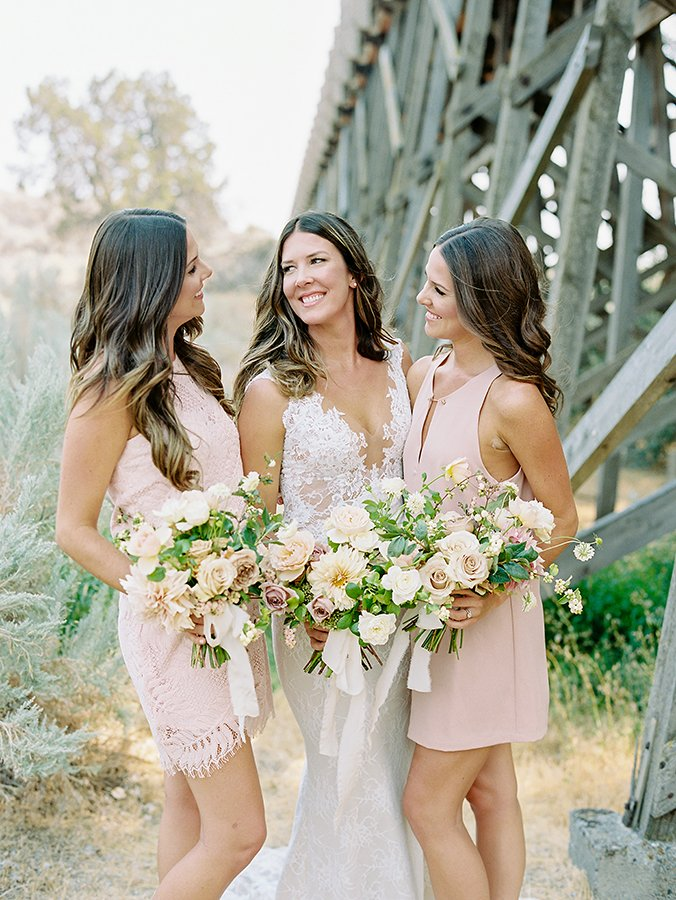 Wedding portrait of bride and her sisters