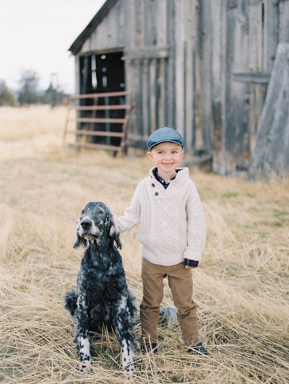 A portrait of a boy and his dog by Marina Koslow