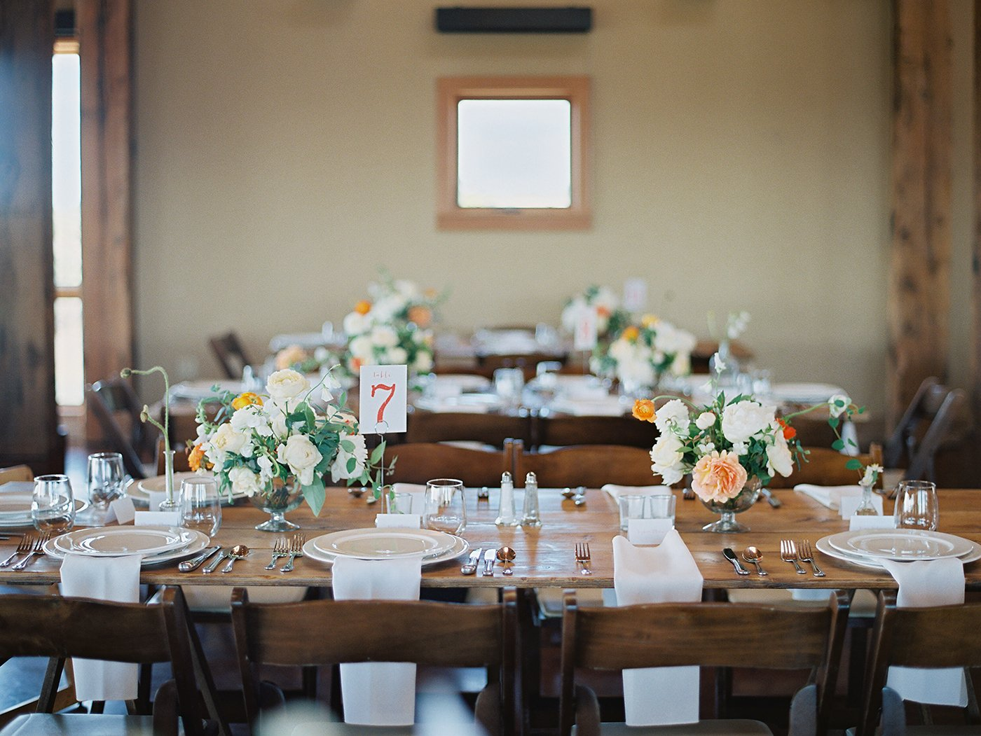 Farm tables at wedding reception