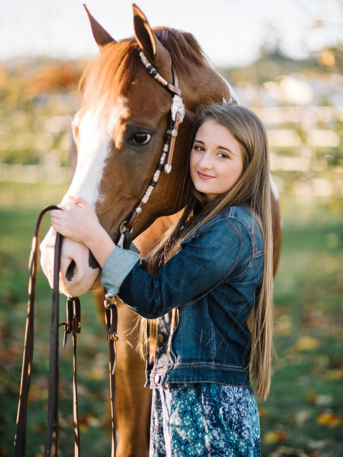 Senior portrait of a girl and her horse