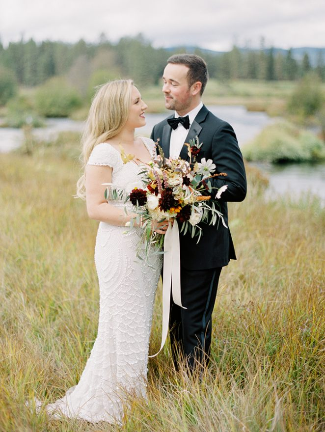 bride and groom look at each other smiling during their wedding at House on Metolius